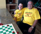 Colton Cardie (cq) sits with his Grandpa, John Cardie (cq) after playing checkers in Arvada Sunday...