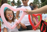 5 year-old Citlalli Aguayo (CQ) receives a balloon heart at Garfield Lake Park in Denver. Newly...