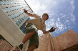 Hunter Neiblum (cq), 15, of Evergreen, prepares to do a leap while practicing Parkour in downtown...