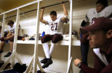 (DENVER, Co., SHOT 9/24/2004) Idalia's Blake Cure (#27), a junior on the team, listens on with...