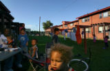 Three year-old Donovan White (cq) (at center) spends time with his friends and neighbors at the...