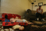 One year-old Toby Jiron (cq) and his brother, 2 year-old Romeo Jiron (cq) sleep on the floor of...
