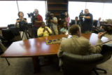 DLM1330  Pastor Brady Boyd, bottom right,meets with reporters during a press conference after the...
