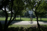 A cyclist rides his bike through Burnham Park in the Chicago neighborhood Hyde Park, where Barack...