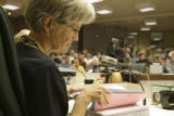 Mary Blue, Longmont City Council Member, flips through the Union Annexation proposal binder at the...