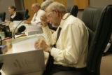 Doug Brown, Longmont City Council Member, reads over the Union Annexation proposal binder at the...