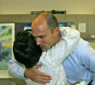 Sean Menke, right, is greeted by Frontier employee Marian Gonzalez (cq), Tuesday afternoon, August...