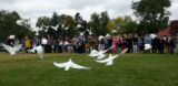 (Denver, Colo., September 22, 2004) White doves were released and fly over those who attended the...