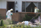 A member  of the Boulder County Drug Task Force removes evidence from the scene of a suspected...