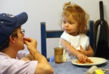 Mary Ross (cq) talks sign language to her newly adopted 2 year-old daughter Evinn DiClementi/Ross...