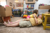 Jeannie DiClementi (cq) plays with her 4 year-old daughter Morgan, at their apartment in Denver,...