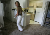 Transgender Aurora Police Det. Renee Grahn (cq) searches an apartment August 13, 2007, where a man...