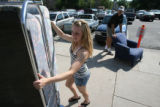 Colorado State University freshman Ashley Ooley, cq, of Ft Collins  moves her couch to her dorm...