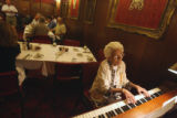 Rocky Ford resident Betty Smith (cq) plays the piano for the weekley Rotary Club meeting in Rocky...