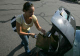 Jessica Yaw (cq) loads groceries into her car at Wild Oats at 11th and Ogden in Denver on...