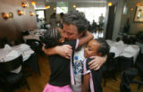 Ruthie Perdue, center, Co-founder of Children of Ethiopia Education Fund, gives a hug to Semhar...