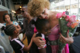 Selamawit Wendemu, 12, gets a hug from Cleo Parker Robinson, right, at Strings Restaurant in...