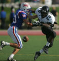 Anthony Rattler, left, of Cherry Creek forces Savon Cadd, right, of Montbello to fumble the ball...