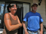 Jennifer Elder (cq) stands on her porch near  East Kentucky Avenue at Waco Way with husband Duane...