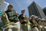 the Colorado State marching band dance as the perform at a pep rally in downtown Dener on Friday...