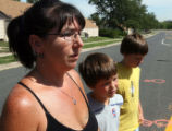 Jennifer Elder (cq) stands with sons Brandon Kelly (cq) and Logan Kelly (cq) on East Kentucky...