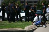Police from Denver and Auraria Campus talk near subjects apprehended and later released during a...