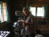 Charlotte Trego pours a cup of water, while in one of the cabins at 30-Mile Resort, Tuesday...