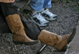 Charlotte Trego (cq), left, wears cowboy boots while talking to a friend, Sara Morlan (cq), from...