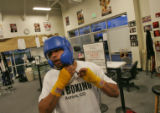 Fernando Rodriguez, 17, of Aurora gets ready for a practice sparing match Thursday evening August...