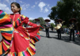 Paulina Villa Senor (cq) dances down Main Street with mariachis as part of the Three Margaritas...