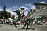 Jose Galvan (cq), from Three Margaritas, dances his horse down Main Street in Louisville during...