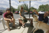 left to right, Craig Georgalas and Jennie Kuchta meet Woody with the help of Natalie Senske, (cq...