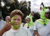 Nathanael Smith (cq), 11, from Broomfield, tries to be patient while he has his alien make-up...