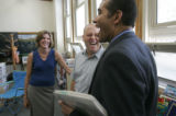 0870 Jaime Aquino, right, chief academic officer for the Denver Public Schools, laughs with Frank...