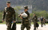 Aiir Force Cadets Chris Goetz , left and Alicia Robillard, carrying books, make their way to...