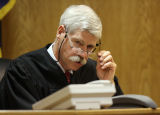 Park County Judge Charles Barton (cq) watches as Robert Amos (cq) enters a Park County courtroom...