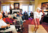 Janet Kuivila (cq), a tap dancer from Cream of the Crop, an entertaining group of seniors who...