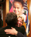 Bruce Randolph School Principal Dr. Kristin  Waters, right,  is congratulated with a hug by DPS...