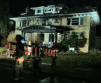 Denver firefighters mop up a  house fire at 5:40 am  in the 1400 block of Madison Street Thursday...