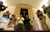 0125 Members of the Medhanealem Ethiopian Orthodox Tewahedo Church test the acoustics with a hymn...