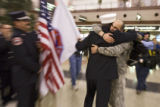 DM0658   Sgt. Jens Pietrzyk, 27, right, gets a hug from Capt. Monte Fleming as he is greeted by...