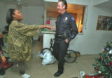 Janet Williams (cq) thanks Aurora Police Officer Tom Muldoon (cq)  in her apartment Friday...
