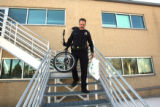 Aurora Police Officer Tom Muldoon (cq) carries Chrismas presents out of District One Headquarters ...
