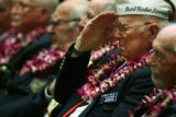 MJM874 Pearl Harbor survivor, Wilmer Bailey (cq), 86, salutes as taps are played during a memorial...