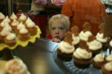 Joe Yoder, 3 gazes at a display of the tiny cakes of Happy Cakes at the new  bakery in Denver,...