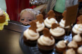 Joe Yoder, 3 gazes at a display of the tiny cakes of Happy Cakes in Denver, Colo on December 7,...