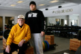 Eddie Crowder and Kai Malava, sit in the weight room at the Dale Ward Center at the University of...