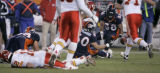 0872 Denver Broncos Nate Webster, right, eyes a Kansas City Chiefs Brodie Croyle, left, fummble in...