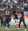 1107 Denver Broncos Champ Bailey, left, and teammate Ian Gold celbrate Bailey's interception...