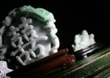 A carving of 'Double Happiness' which is $3500 and a Buddha  for $800 are available at Jade Room...